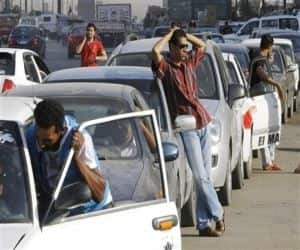 Egyptian drivers wait outside in long queues at a gasoline station in Cairo, Egypt. Egypt's political turmoil is dangerous for economic reforms which is awaiting USD 4.8 billion IMF loan. If the loan is put on hold, Egyptians may face a deterioration in the crisis. From worsening fuel shortages and blackouts, there will be a further depreciation of the currency and a depletion of foreign currency reserves that could make importing critical oil and food items difficult.
