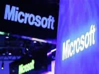 Microsoft profit below estimates after tablet charge