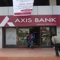 Axis Bank up 6% but asset quality worries, analysts cut target