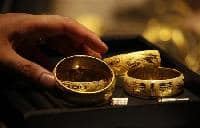 Gold drops Rs 180 on subdued demand, global cues