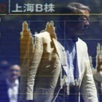 Asian stocks mixed as BOJ maintains monetary policy