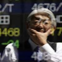 Asian markets trade lower; Greece, oil jitters eyed