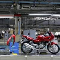 Bajaj Auto unveils new bike 'V'; price up to Rs 70,000 likely