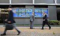 Nikkei gains on upbeat US corporate earnings, data