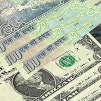 Indian rupee opens lower at 61.89 per dollar