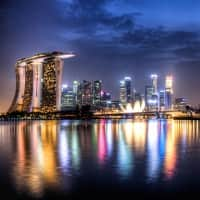 Singapore tops growth forecast, central bank stands pat