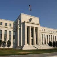 Hawk and dove, two Fed officials see steady cuts to QE3