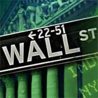 Wall Street ends higher as blue chips rally; Intel up late