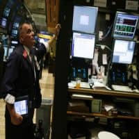 Wall St rises after Fed minutes on 'easy money' exit