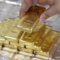 Gold dips after 7-day rally but set for second weekly gain