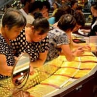 Gold near multi-yr lows as US data supports rate hike view