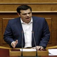 Greece makes debt repayment, minister calls for snap polls