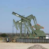 Oil stable on firm demand, supply disruptions; strong $ weighs
