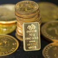 Gold edges lower as investors await central bank decisions