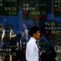 Asia gains on BoE easing boon, key US jobs data awaited