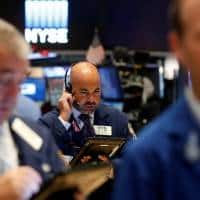 Wall Street ends flat as investors assess US rates outlook