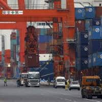 Japan exports fall more than expected, eyes on BOJ review