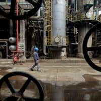 Oil prices fall on higher OPEC output, rise in US crude stocks