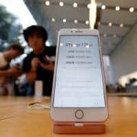 Apple iPhone sales fall but beat estimates; shares slip