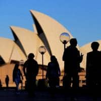 Australia economy slams into reverse, hopes to dodge recession