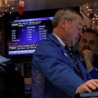 Wall Street rises, led by banks; Dow brushes against 20,000