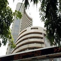 Sensex, Nifty open flat; Bank of Baroda rebounds, GVK up 16%
