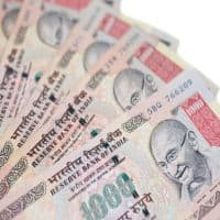 Rupee opens lower at 67.22 per dollar