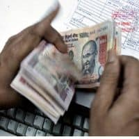 Rupee pares initial losses, trading flat at 67.36 vs dollar