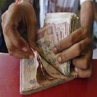 Govt must review tax on cash deals over Rs 2 lakh: Assocham