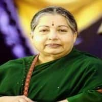 Jayalalithaa laid to rest next to her mentor MGR