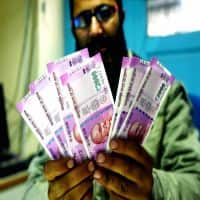 Rupee trips 14 paise against dollar; Trump speech in focus
