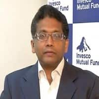 Mkt to face reality check soon, +ve on pvt banks, IT: Invesco MF