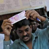 India's cash crunch seen biting into economic growth: Poll