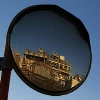 Oil edge up on Iran tensions, but rising shale output caps gains