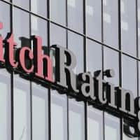 High govt support to deal with stressed asset 'negative': Fitch