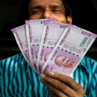 Expect USD-INR to trade between 64-64.50: Pramit Brahmbhatt
