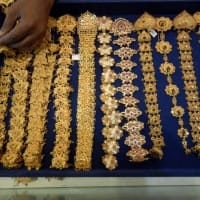 Gold falls below 1-month high as dollar, Treasury yields rise