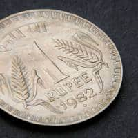 Indian rupee opens lower at 64.17 per dollar