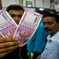 Indian rupee takes cues from stocks recovery, at 64.56