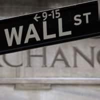 Nasdaq tops 6000 as earnings boost Wall Street; US tax code eyed