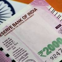 Rupee settles 6 paise higher at 71.59 against US dollar